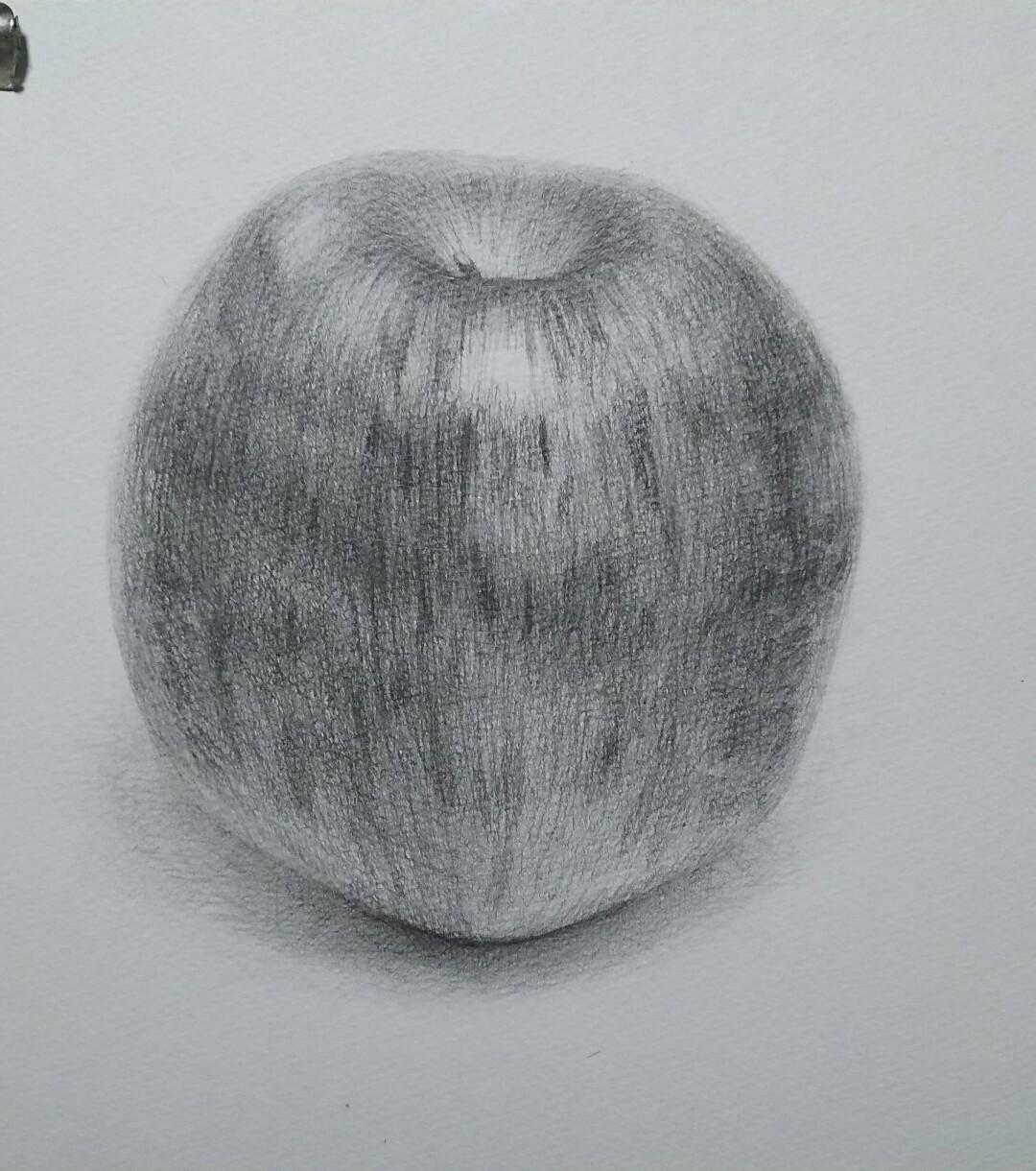 赤いりんご、順光気味、白い紙の上に配置