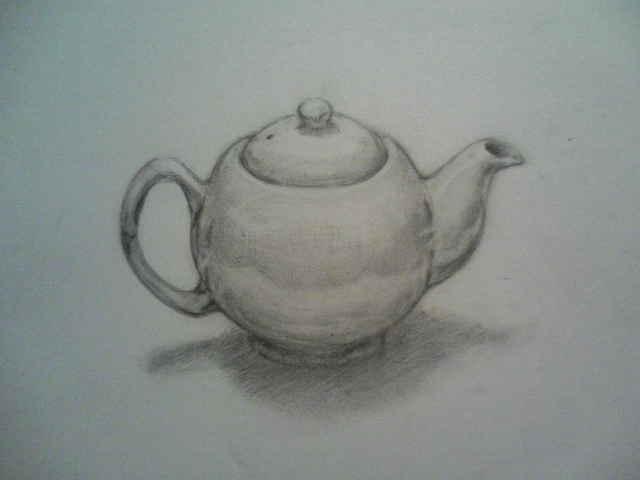 白い陶器のティーポット