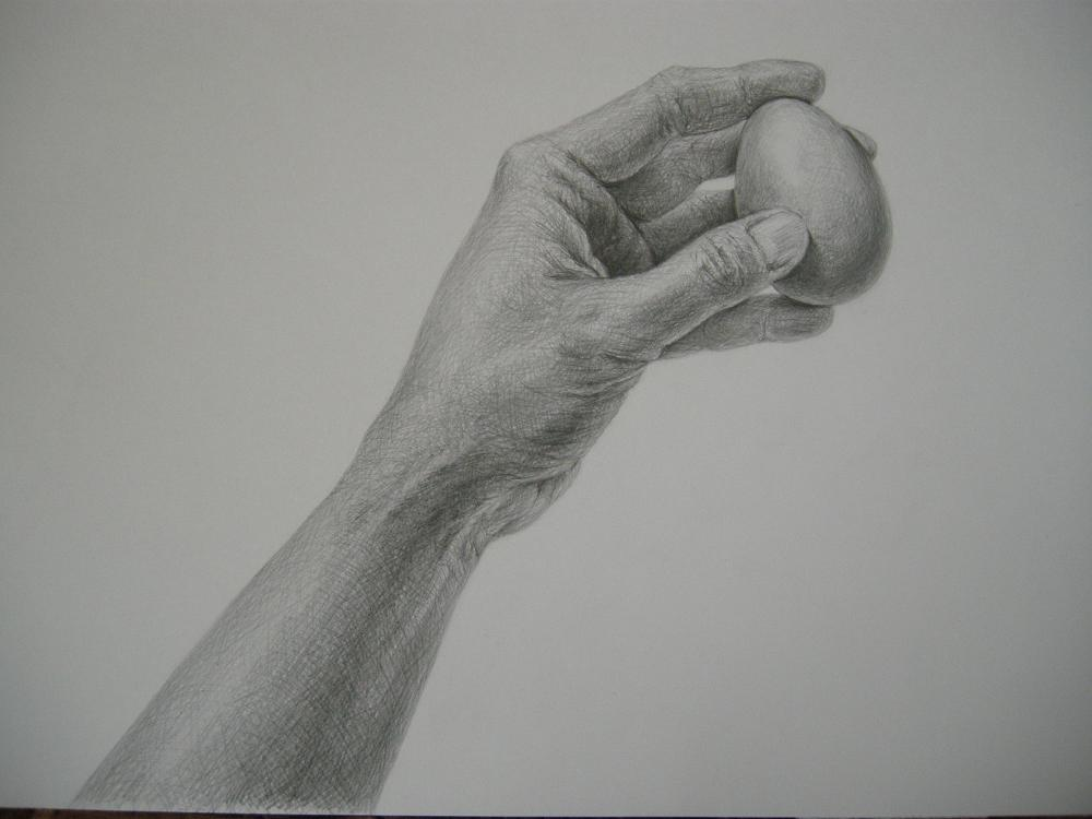 Re: 茶色い卵を持った手