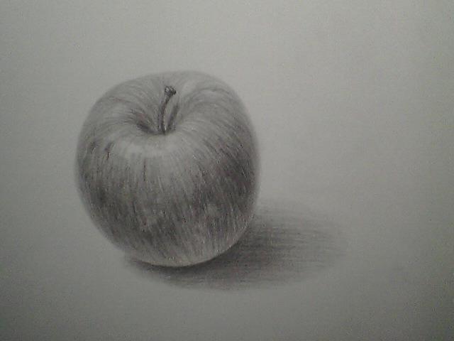 傾いたりんご