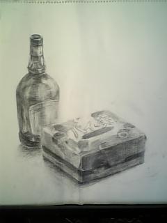 カシスリキュールの瓶とパイの実