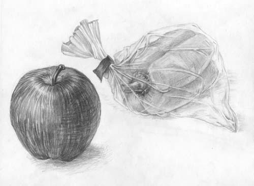 リンゴと透明のビニールの袋に入ったパプリカ