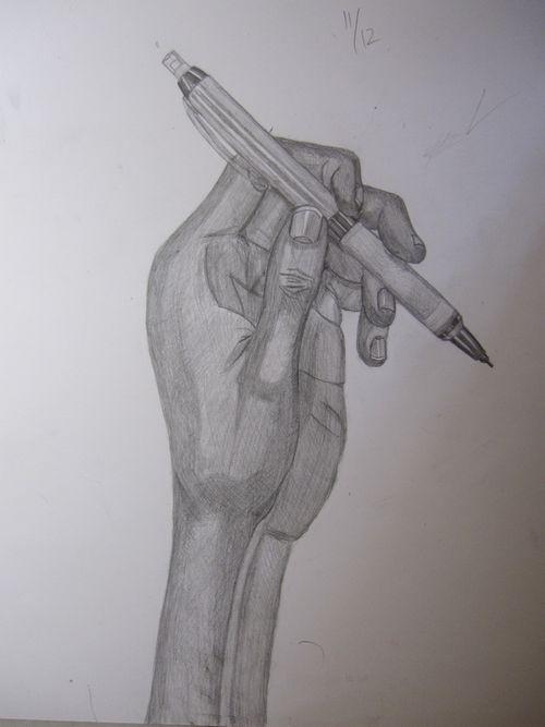 手とシャープペンシル