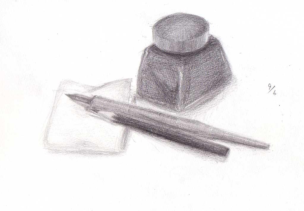 インクとティッシュの上のペン、鉛筆